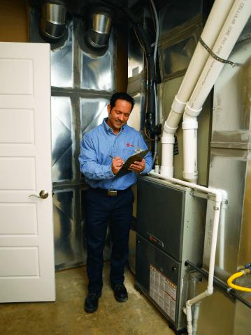 A tech checks a heater maintenance task off his list