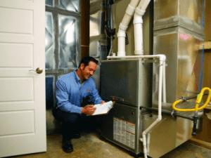 A technician checks on a heater