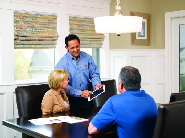 A representative discusses options with Lantana homeowners