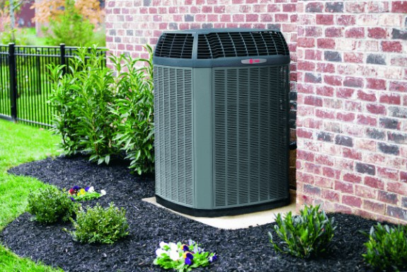 Outdoor AC unit next to house
