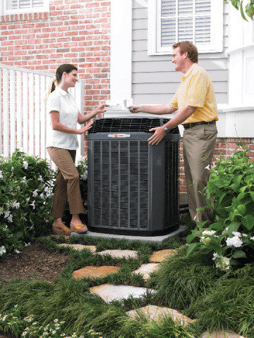 A service tech shows a Flower Mound homeowner the source of the problem