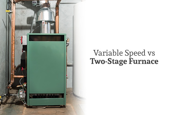 "A picture of a green electric furnace beside the words ""Variable Speed vs Two-Stage Furnace"""