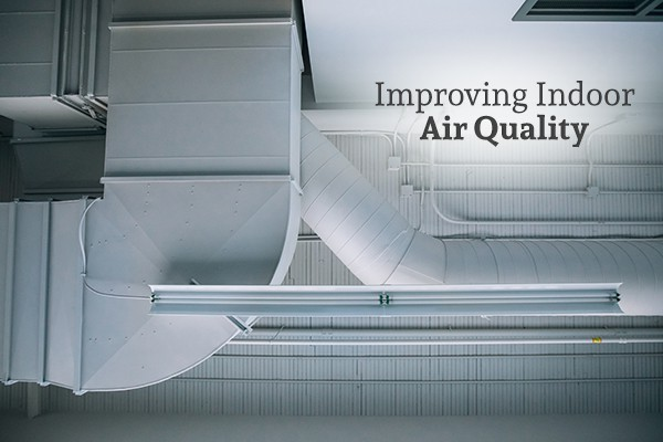 Air ducts on the ceiling with the words improving indoor air quality