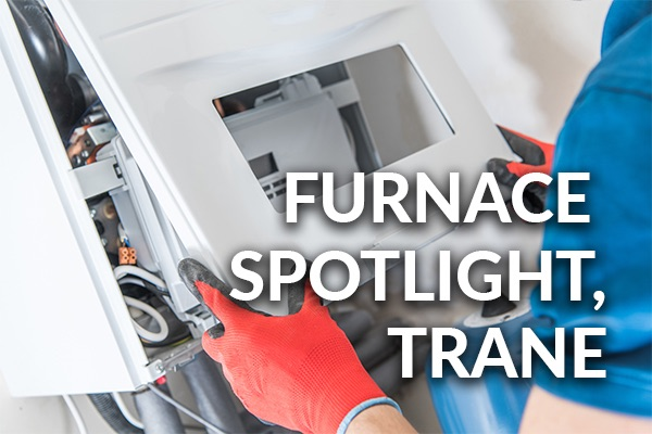 A technician working on a furnace with the words, furnace spotlight, trane