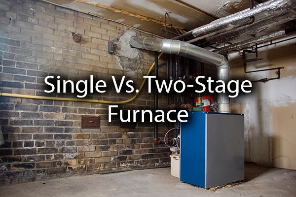 A furnace in the basement with the words, single vs, two stage furnace.