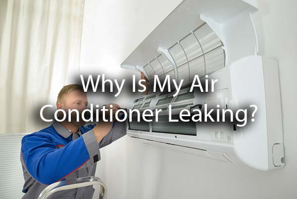 An HVAC technician working on an air conditioner with the words, why is my air conditioner leaking?